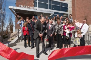 Lawrence Thatcher cuts the ribbon for the new Thatcher Building for Biological and Biophysical Chemistry as his family looks on - Photo Credit: University of Utah Office of Development